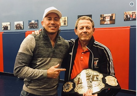 GSP gives away his UFC belts after every win